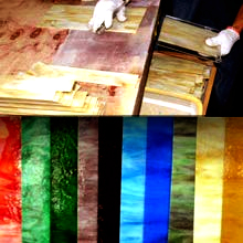 stained glass, many colors and patterns, cutting manually the stained glass sheets
