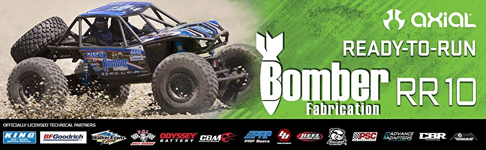 SIde view of Axial blue and black RR10 Bomber rock racer in action
