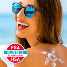 Woman smiling at the beach - Face and body sunscreen lotion can be covered by FSA & HRA accounts