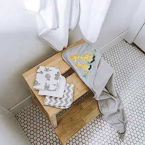 bath time towels washcloth folded footstool