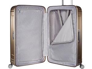 intérieur de la valise, sangles élastiques croisées, plateau de séparation zippé