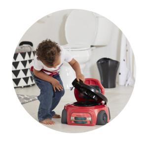 Kid using the Training Wheels Racer Potty seat