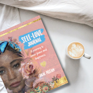 diary on bed with coffee
