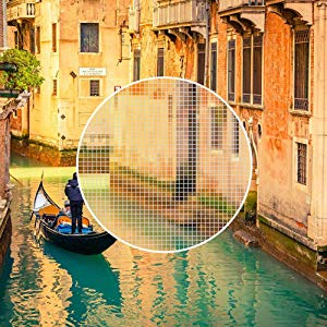A picture of venice with a circle in the center showing pixel detail