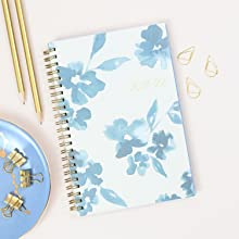 blue sky bakah blue academic planner,closeup of planner cover with pencils and office accessories
