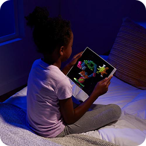 New Lifestyle Image (kid showing off Lite Brite Design)