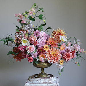 pink and orange asymmetrical flower arrangement