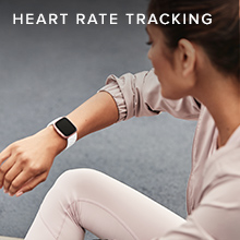 Woman checking heart rate on her fitbit watch