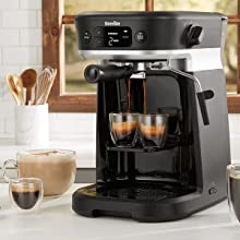 All-in-one coffee machine in kitchen, dispensing 2 cups of espresso