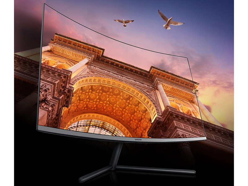 Angled view of Samsung UR59C 4K UHD Monitor to show curved,  immersive viewing