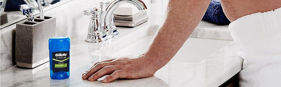 gillette clinical deodorant power rush clear gel, man in bathroom, sink, deodorant, antiperspirant
