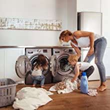 modern family doing laundry with kids and dog