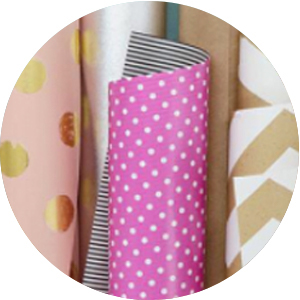 Hallmark gift wrap including pink and gold wrapping paper, kraft paper and polka dot gift wrap