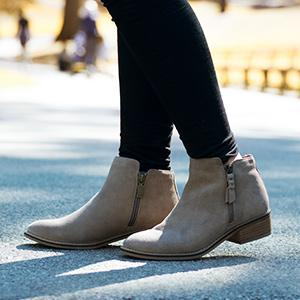 e81e59740940 Style. A stepped topline and stacked woodgrain block heel freshen the look  of a waterproof suede bootie ...