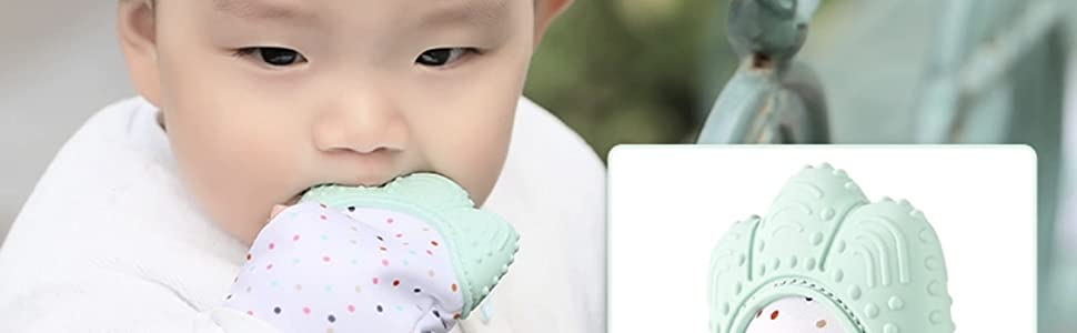 Close-up of baby chewing on Jambu Beads Teething Mitten