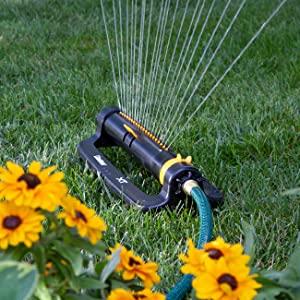 Melnor Oscillating Sprinkler watering a lawn