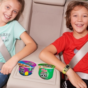 Kids can take Raisin Bran Crunch and Apple Jacks cereal cups as snacks on the go in a car or SUV