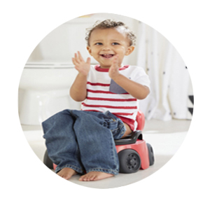 Kid sitting in Training Wheels Racer Potty seat