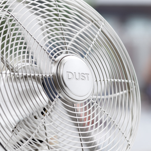 silver rotary fan that says the word dust in the center of it