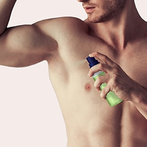 shows a man spraying duo that is shaken and activated. Spraying it directly on skin