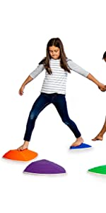 Children playing on JumpOff Jo's RockSteady Balance Stepping Stones