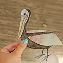 Once my pelican is done, I cut it out using very fine and sharp scissors.