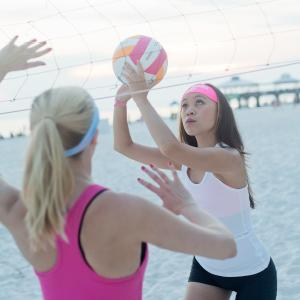 Ladies playing volleyball wearing Bondi Band Headbands