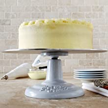 metal cake stand with decorated cake