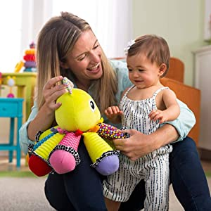Baby playing with Lamaze Toy