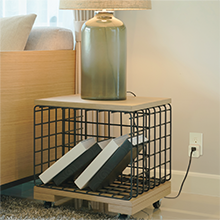 Side table with lamp featuring HALO Home Smart Plug in wall outlet