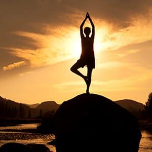 woman doing yoga pose at sunset