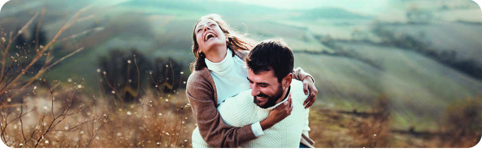 Happy smiling couple, enjoy a hike in beautiful rolling hills.