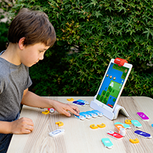 Tangible interaction with the game require movement of tiles by child to move the game forward
