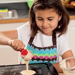 Girl making pancakes from Cooking Class
