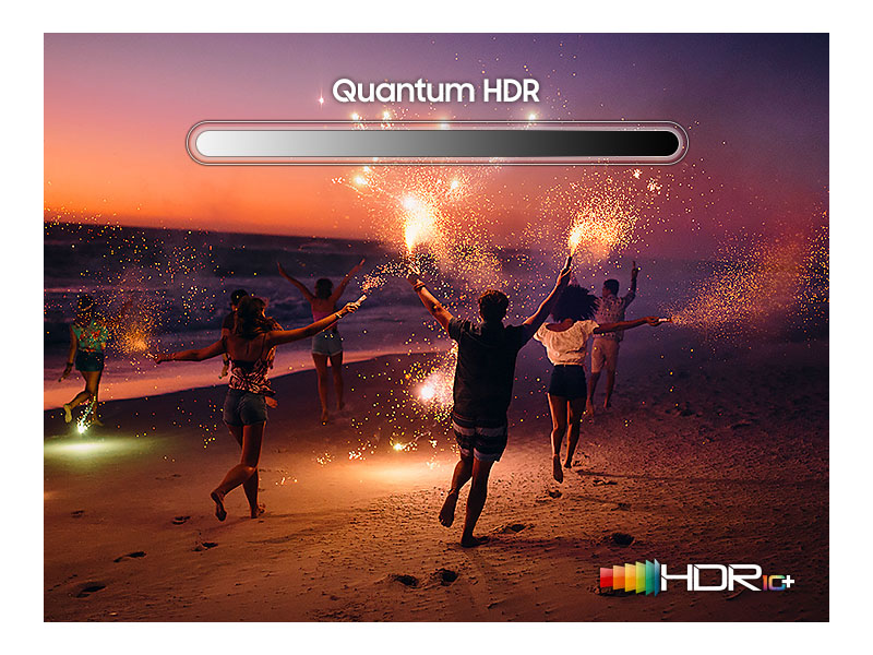 People on a beach with sparklers showing HDR contrast and brightness