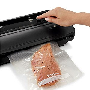 FoodSaver Press vacuum and seal button.