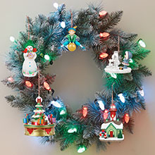Hallmark Keepsake Christmas ornaments with light and sound on a magic Christmas wreath