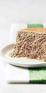 Wet cat food pate unpacked on a plate