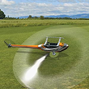 Screenshot of grassy flying field with inverted RC helicopter flying in foreground