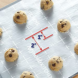 Evenly space cookies with Reynolds Kitchens Parchment Paper with Smart Grid