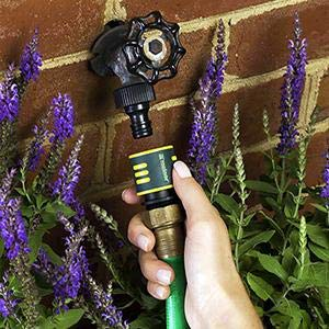 QuickConnect being used to connect a hose to a faucet