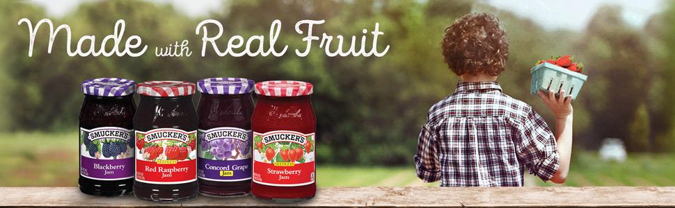 Smucker's Blackberry Jam, Red Raspberry Jam, Concord Grape Jam and Strawberry Jam with boy in field