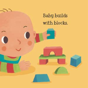 Baby builds with blocks