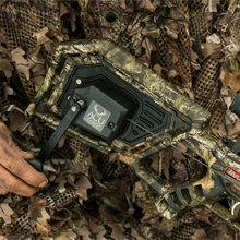 Hunter cocking Wicked Ridge crossbow with ACUdraw cocking device.
