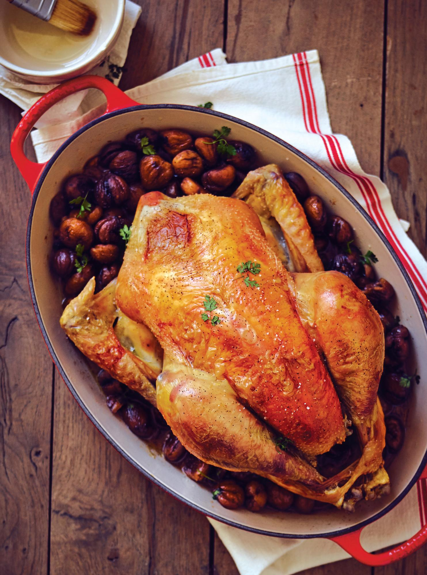 large capacity le creuset with roasted turkey inside