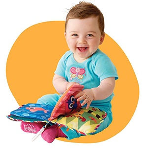 Baby Looking at Lamaze Peek-A-Boo Forest Soft Book