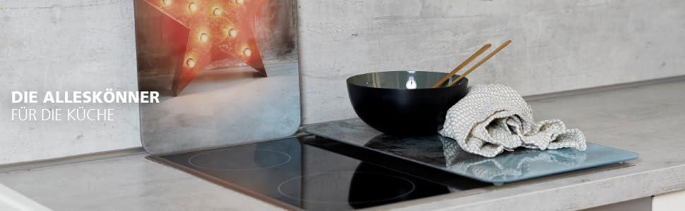 Wenko ovendekplaten en spatbescherming – praktische keukenhulp met kleur en functie.