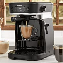 All-in-one coffee machine in kitchen, dispensing pod coffee