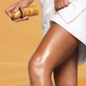 Person applying Neutrogena Micromist Sunless Self Tanning Spray Mist to legs for a healthy glow