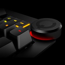 Dedicated Media Controls - previous, play/pause, and next. Circular mute button and volume knob.